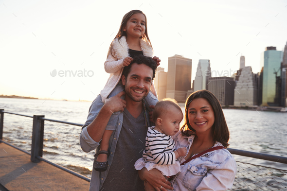 Young family with daughters standing on quayside, close up - Stock Photo - Images