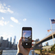 Tourist Taking Photo Of Manhattan Skyline On Mobile Phone - PhotoDune Item for Sale