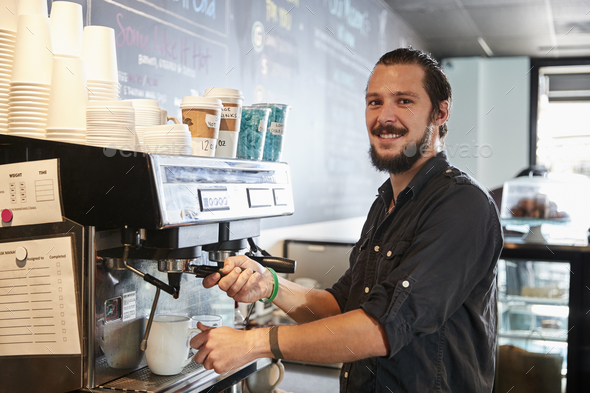 Portrait Of Male Barista Behind Counter In Coffee Shop - Stock Photo - Images
