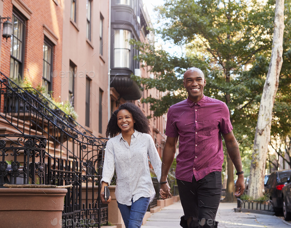 Young Couple Walking Along Urban Street In New York City - Stock Photo - Images
