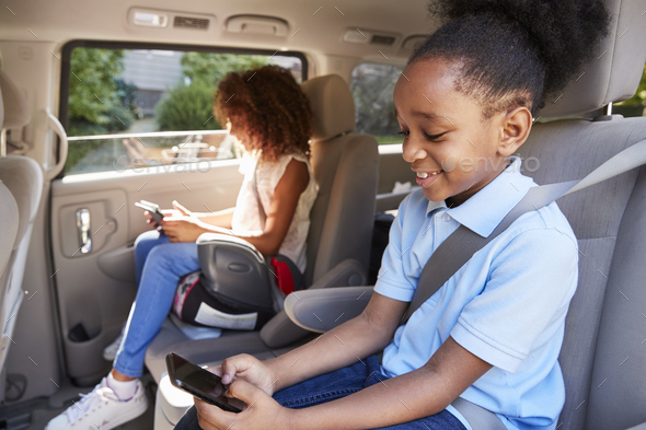 Children Using Digital Devices On Car Journey - Stock Photo - Images