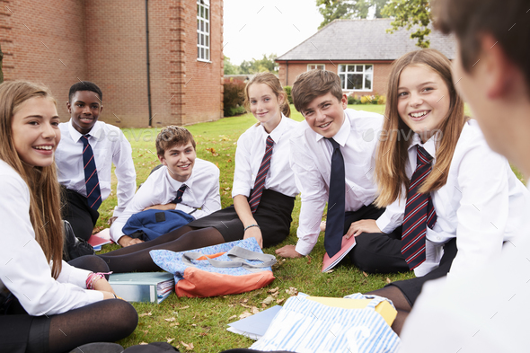 Teenage Students In Uniform Working On Project Outdoors - Stock Photo - Images