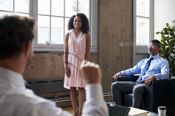 Female manager standing at informal meeting, close up - Stock Photo - Images