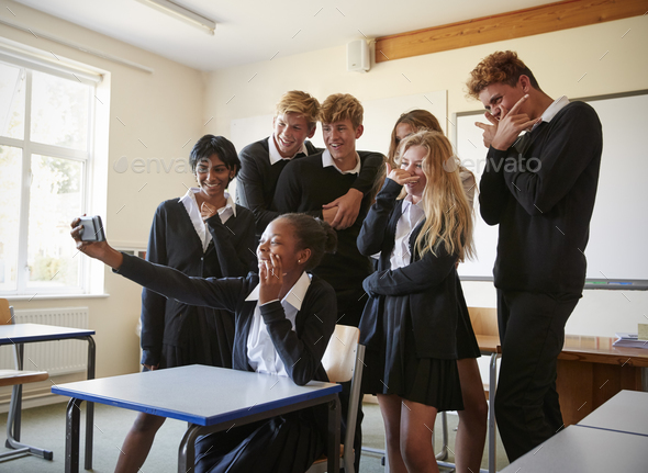 Group Of Teenage Students Posing For Selfie In Classroom - Stock Photo - Images