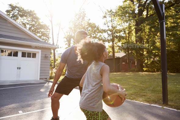 Father And Son Playing Basketball On Driveway At Home - Stock Photo - Images