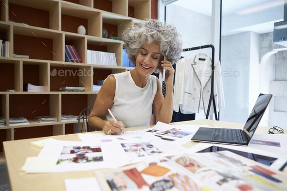 Senior female media creative working on the phone - Stock Photo - Images