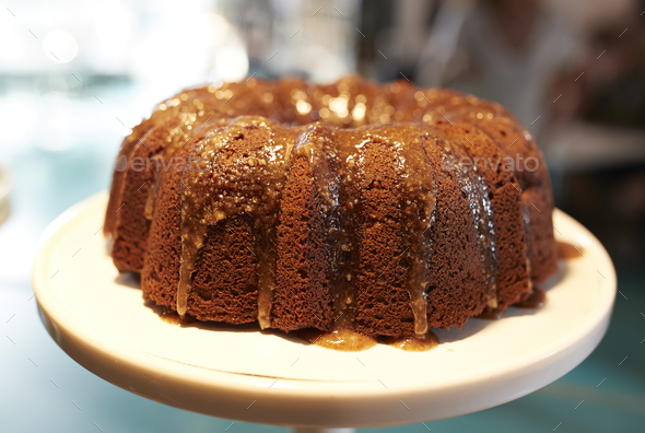 Freshly Baked Treacle Cake On Stand In Coffee Shop - Stock Photo - Images
