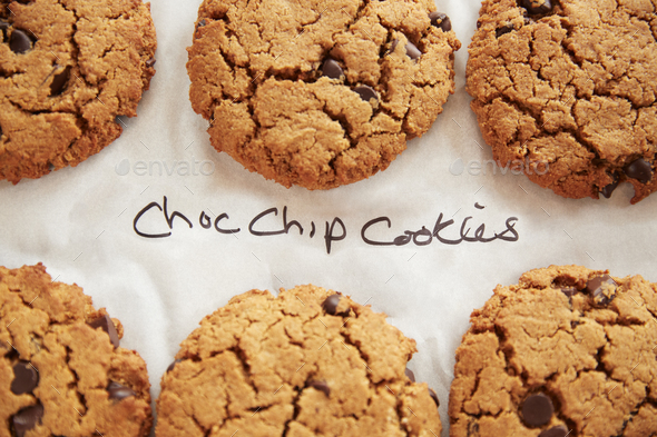 Display Of Freshly Baked Choc Chip Cookies In Coffee Shop - Stock Photo - Images