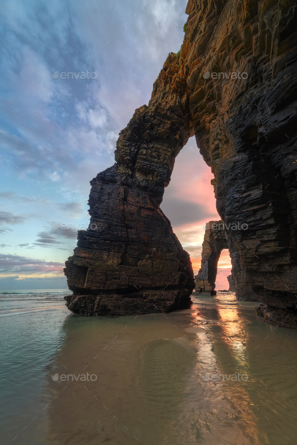 Dawn between the stony arches - Stock Photo - Images