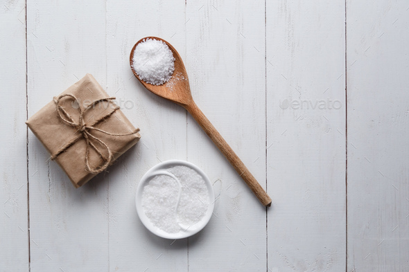 Healthy Sea Salt with giftbox on white wooden background. Flat lay. Copy space. - Stock Photo - Images