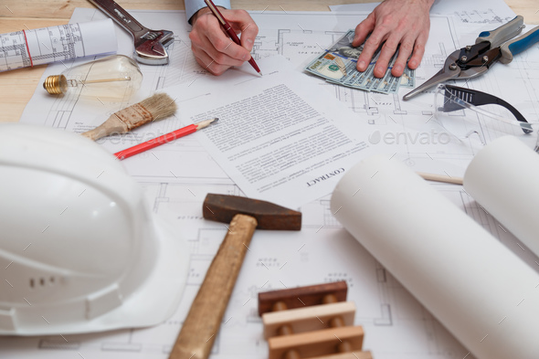 Signing of the contract and payment for construction and engineering works - Stock Photo - Images