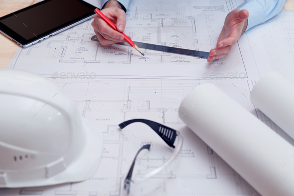 Chief engineer or architect works with building drawings - Stock Photo - Images