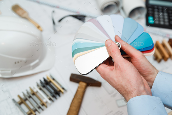 Architect interior's hands drawing home illustration with material sample, renovation concept. - Stock Photo - Images