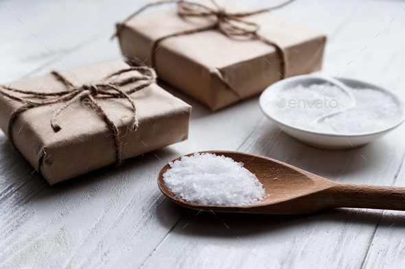 sea salt on wooden background with gift boxes - Stock Photo - Images