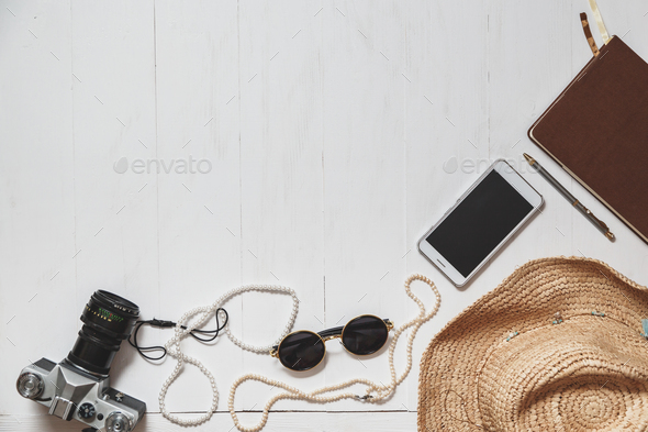 Travel Set of modern girl: female accessories on the white planked surface - Stock Photo - Images