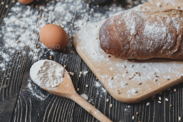 Black homemade bread and its ingredients - Stock Photo - Images