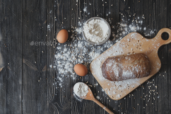 Baking bread at home on a rustic wooden table with space for text layout. View from above. - Stock Photo - Images
