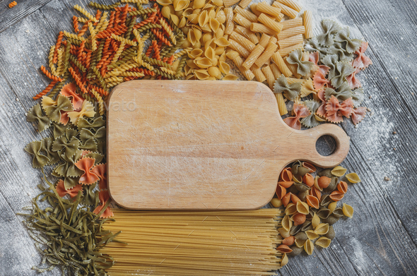 Rustic wooden plaque with space for your text, lined on all sides  different pasta - Stock Photo - Images
