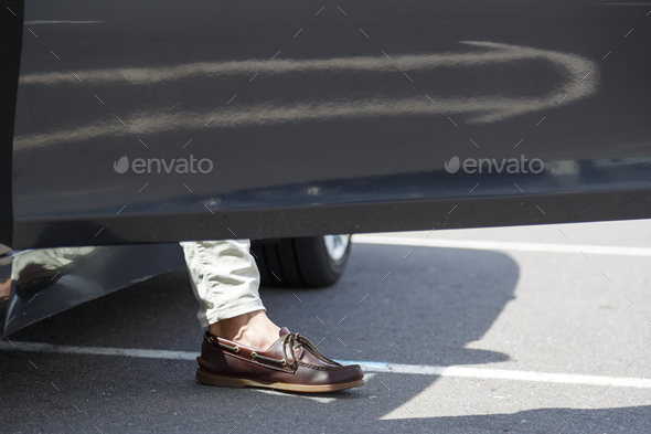 leg stylish men coming out of his car - Stock Photo - Images