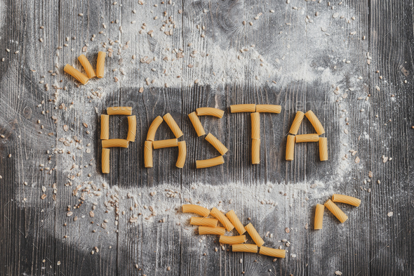 Word pasta,  laid out on an old black wooden desk. - Stock Photo - Images