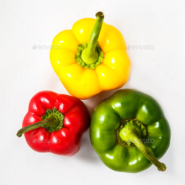 Fresh peppers. Three sweet Red, Yellow, Green Peppers isolated on white background. Top view - Stock Photo - Images