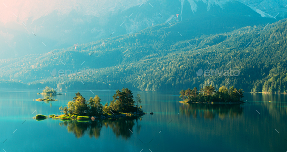 Fantastic sunrise on mountain lake Eibsee - Stock Photo - Images