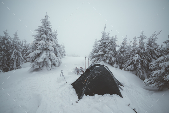 Frozen tents in the high mountain - Stock Photo - Images