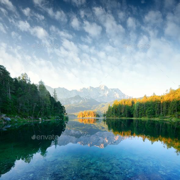 Fantastic sunrise on mountain lake Eibsee - Stock Photo - Images