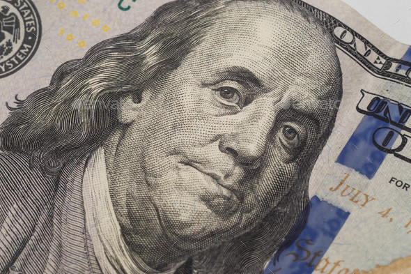 Dollars closeup. Benjamin Franklin's portrait on new one hundred dollar banknote. - Stock Photo - Images