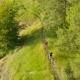 Men Cycling On A Rural Road - VideoHive Item for Sale