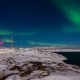 Northern Lights in the Snow-covered Mountains. Norway - VideoHive Item for Sale
