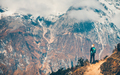 Woman with backpack on the path and mountains - PhotoDune Item for Sale
