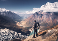 Man with backpack on the mountain peak at sunset - PhotoDune Item for Sale
