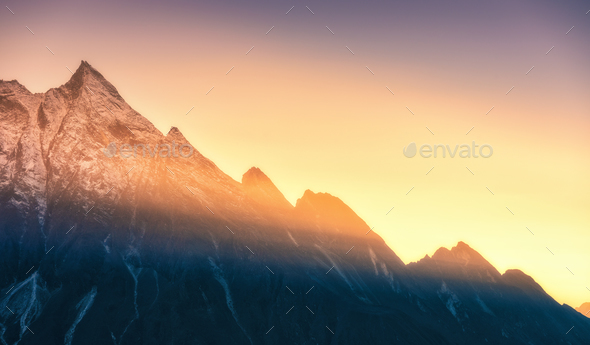Mountains and low clouds at sunrise in Nepal - Stock Photo - Images