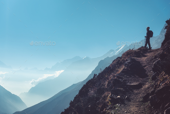 Woman on the hill and mountains at bright day - Stock Photo - Images