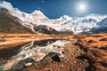 Beautiful mountains with snow covered peaks, stones in lake - PhotoDune Item for Sale