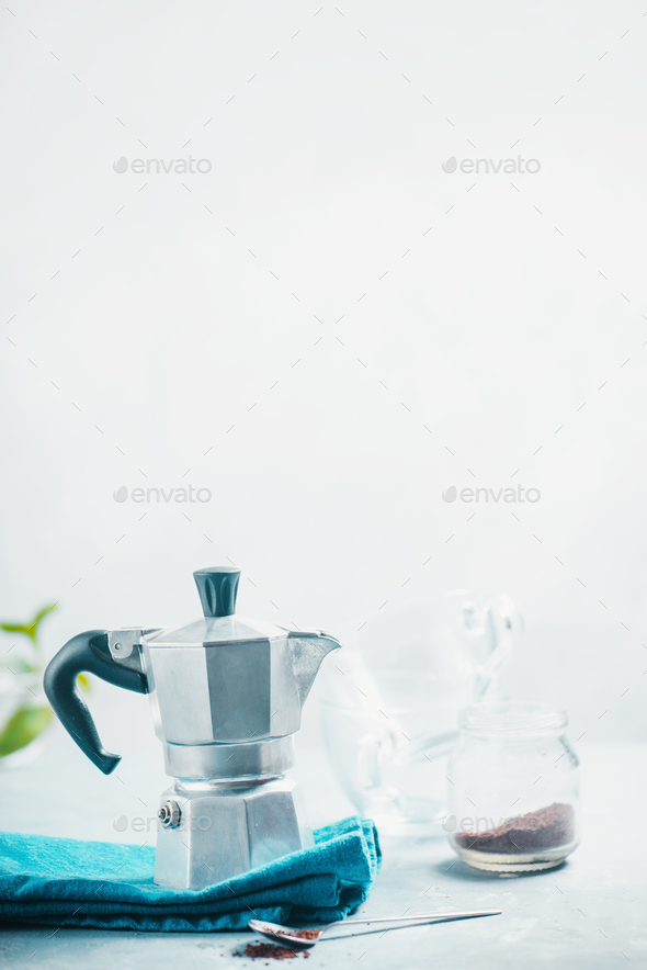 Brewing coffee in Moka pot concept. Morning routine photography with copy space. - Stock Photo - Images