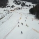 Many Skiers and Snowboarders Descend down the Ski Slope - VideoHive Item for Sale