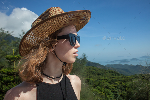 female traveler at sunny summer day on mountains and sea background - Stock Photo - Images
