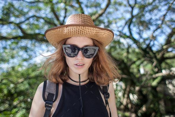 white female traveler on nature forest background - Stock Photo - Images