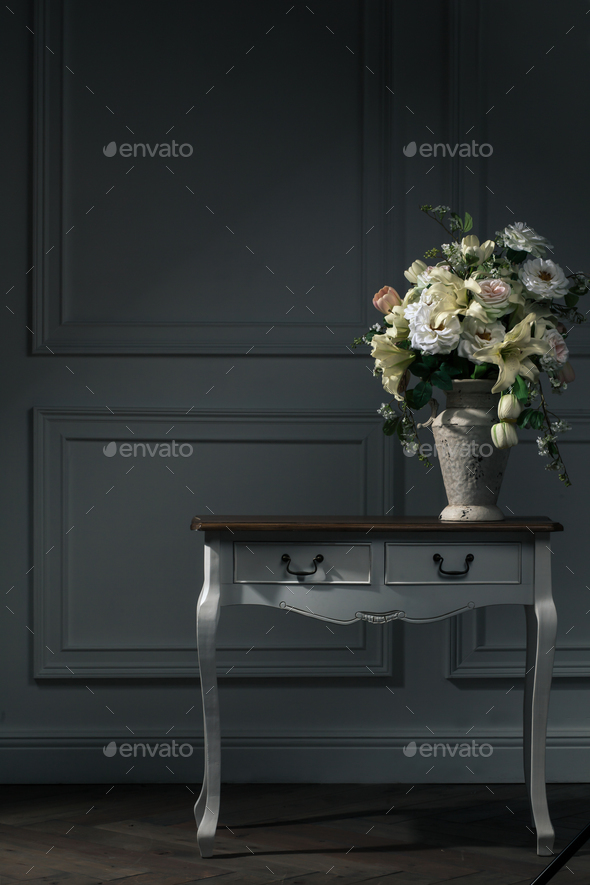 dark interior, table, vase with flowers - Stock Photo - Images