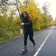 Young Woman on Roller Skates among Beautiful Autumn Trees - VideoHive Item for Sale