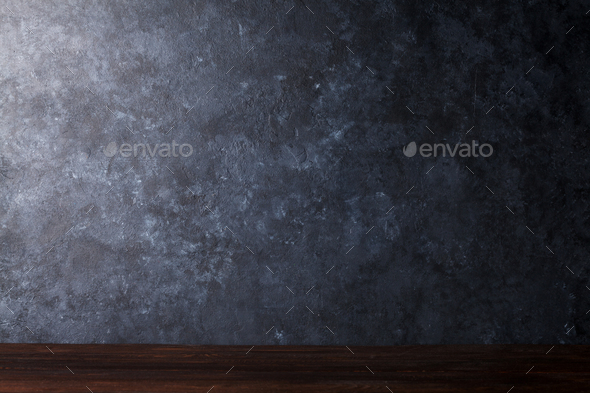 Table in front of chalkboard wall - Stock Photo - Images