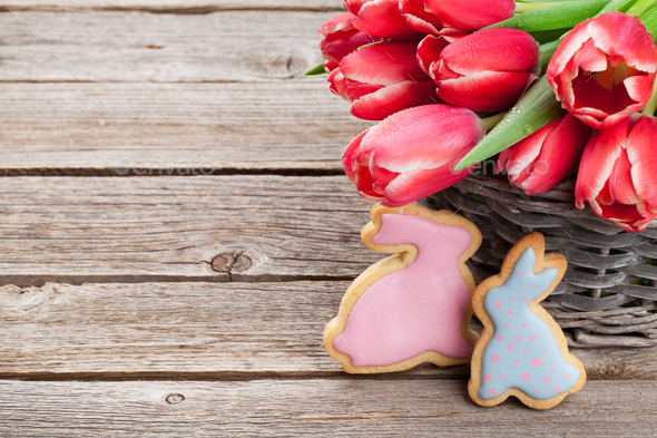 Red tulip flowers and Easter cookies - Stock Photo - Images
