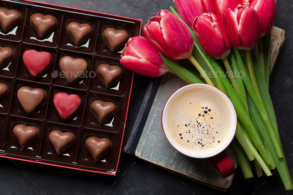 Red tulip flowers, coffee and chocolate hearts - Stock Photo - Images