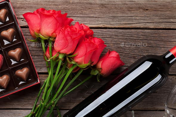 Red roses, wine bottle and chocolate box - Stock Photo - Images