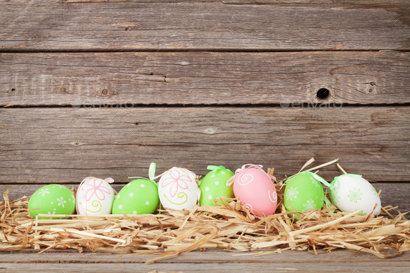 Easter eggs in front of wooden wall - Stock Photo - Images