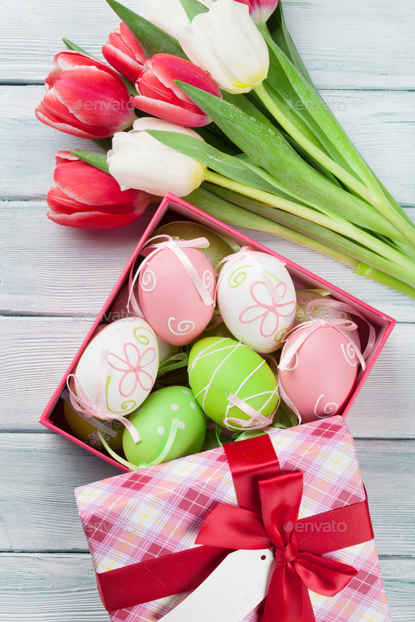 Easter eggs in gift box and colorful tulips - Stock Photo - Images