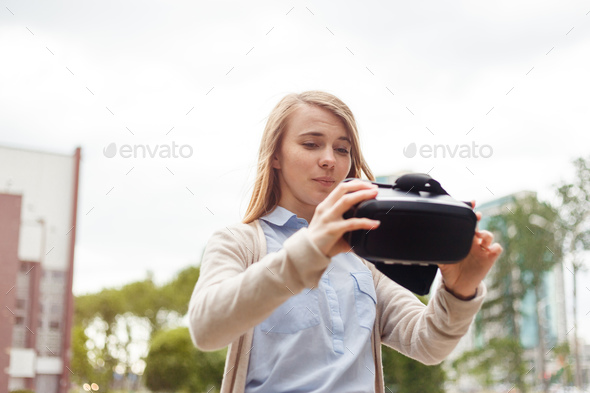Modern technology vr headset in woman hands - Stock Photo - Images