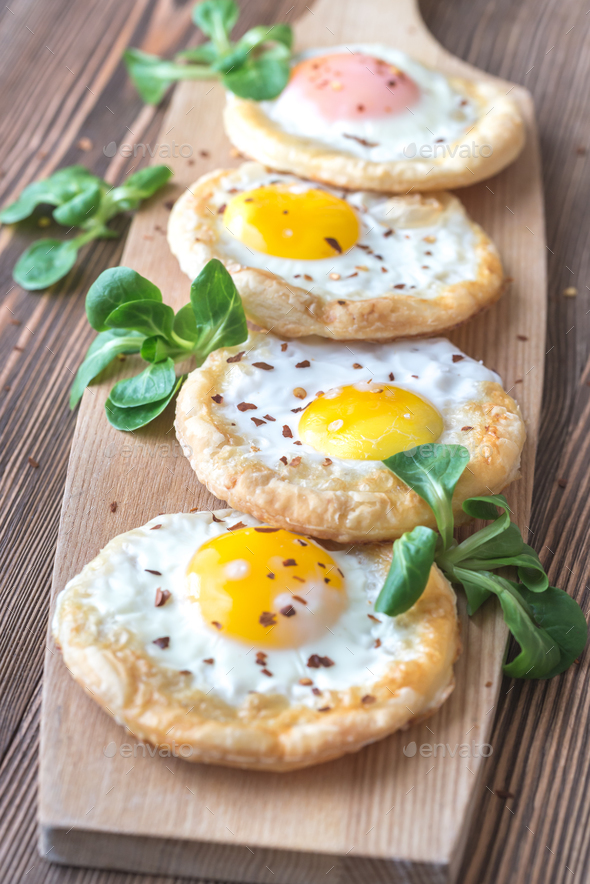 Baked eggs in puff pastry - Stock Photo - Images